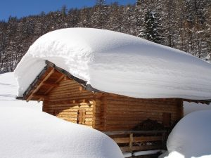 Small building in desperate need of snow removal.