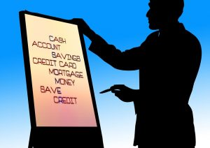 Graphic photo of a man giving a presentation. On the presentation screen are the words Cash, Account, Savings, Credit Card, Mortgage, Money, Save, Credit